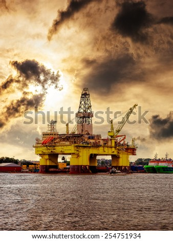 Oil rig moored in the harbor against a dramatic sky.  - stock photo