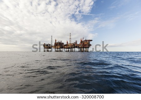 Oil rig platform at sunny day - stock photo