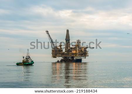 Oil rig platform in the calm sea - stock photo