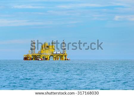 Oil rig platform in the calm sea. - stock photo