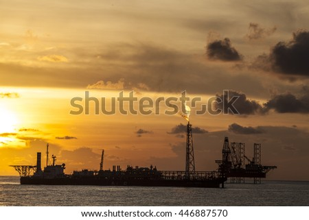 Oil rig platform in the golden hour in the South China Sea - stock photo