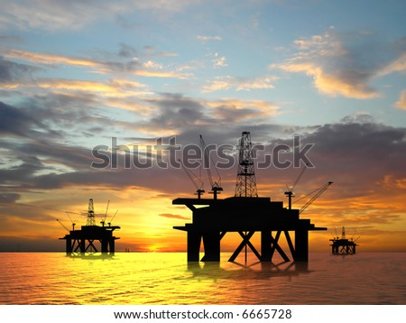 Oil rig silhouette over orange sky