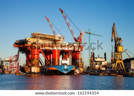 Oil Rig under construction in the shipyard of Gdansk, Poland. - stock photo