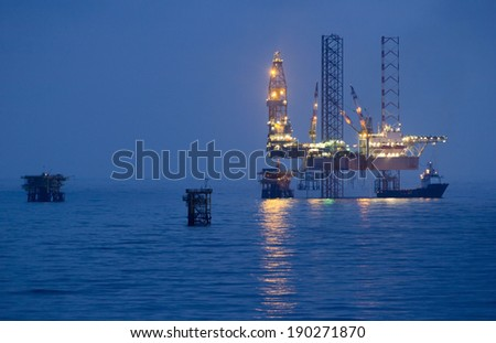Oil rigs in an open sea
