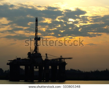 Oil Rigs in beautiful sunrise at Malaysia. - stock photo