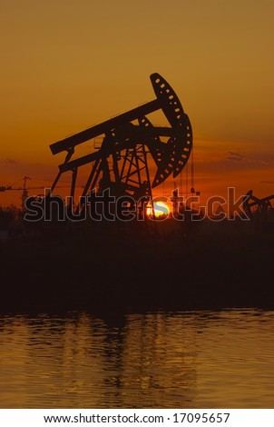 Oil rigs silhouette over orange sky-6