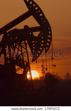 Oil rigs silhouette over orange sky-11
