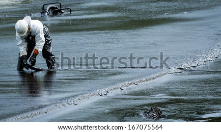 oil spill cleanup at koh samet thailand - stock photo