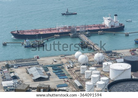 Oil Storage tank and oil tanker - stock photo