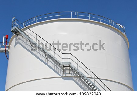 Oil storage tank at a refinery - stock photo