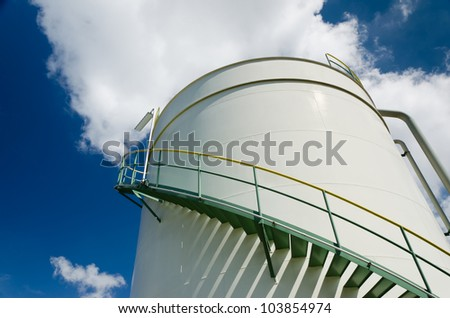 Oil storage tank in petrochemical plant - stock photo