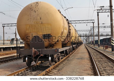 Oil tank cars on the railway station - stock photo