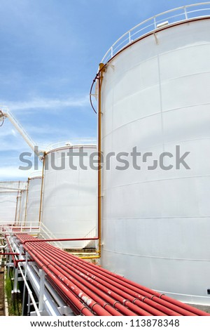 oil Tank farm a large, white color and Blue sky.