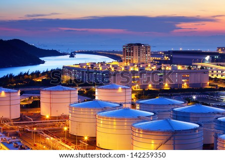 Oil tank in cargo service terminal - stock photo