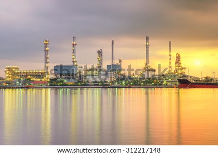 Oil tank ship mooring in oil refinery industry at twilight time - stock photo