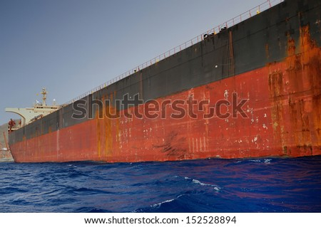 Oil tanker at anchor outside the bay - stock photo