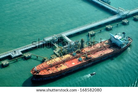 Oil Tanker at refinery plant                                - stock photo