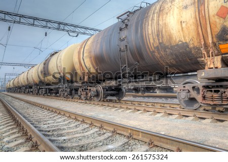 Oil tanker cars on the railway cargo station on a cloudy day - stock photo
