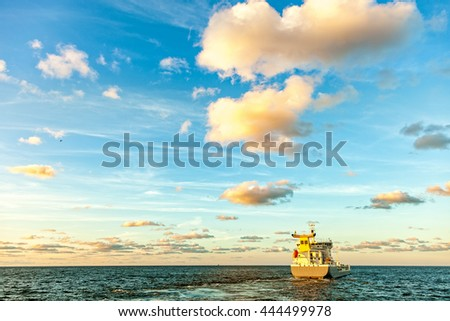 Oil Tanker in the sea at sunset - stock photo