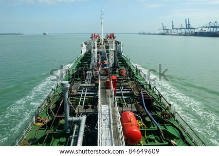 oil tanker is moving to the port