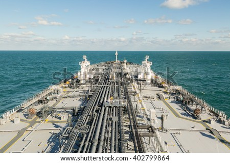 Oil tanker is proceeding in blue ocean under cloudy sky - stock photo. - stock photo