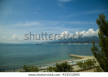 Oil tanker sailing on the sea with beautiful cloudscape in the sky - stock photo