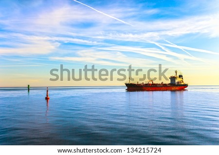 Oil Tanker Ship and buoy in the sea. - stock photo