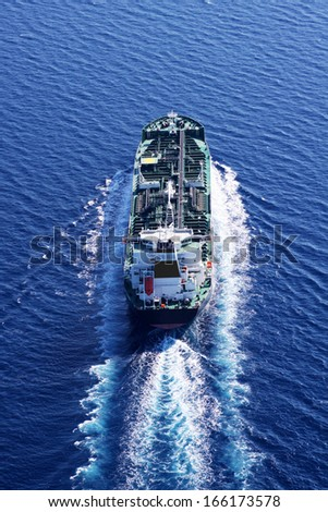 Oil tanker ship on open sea aerial view - stock photo