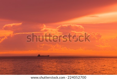 Oil Tanker Ship sailing in cloudy day at twilight time   - stock photo