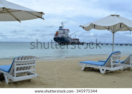 oil tanker transport ship at pier Picnic Center Beach Corn Island, Nicaragua, Central America - stock photo