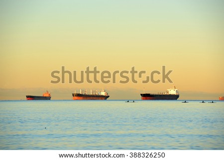 Oil Tankers docked at Port of Vancouver at sunrise, Vancouver, British Columbia, Canada. - stock photo