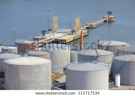 Oil tanks and other silos at Stockholm sea port in Sweden. - stock photo