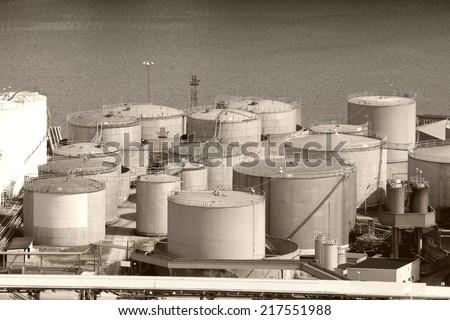Oil tanks and other silos at Stockholm sea port. Sweden. Sepia tone - retro monochrome color style. - stock photo