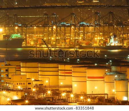 Oil tanks in container terminal - stock photo