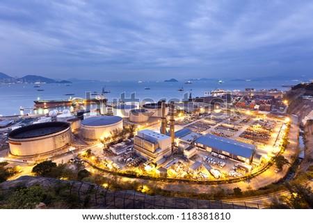 Oil tanks industry scene at night - stock photo