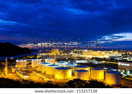 Oil tanks plant at night - stock photo