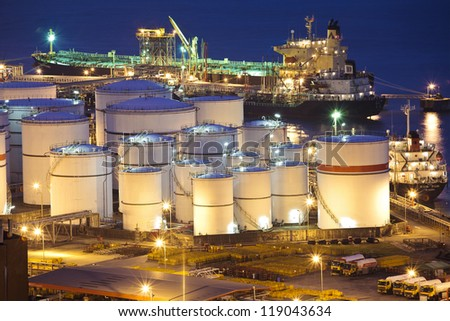 Oil tanks scene at night - stock photo
