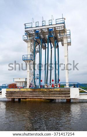 Oil terminal. Equipment for tankers loading on the pier in Varna port, Bulgaria - stock photo