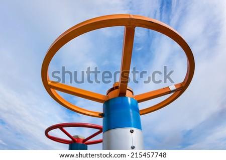 Oil valve on a background of sky - stock photo