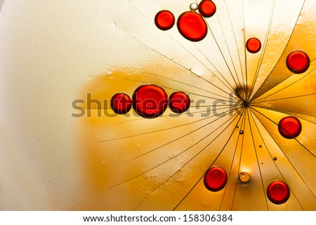 Oil, water, ink and dandelion pieces - stock photo