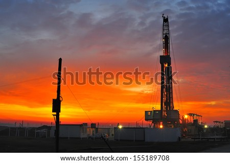 Oil well at night - stock photo