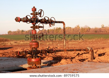 Oil Wellhead in the oil field - stock photo