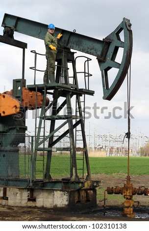 oil worker at an oil field - stock photo