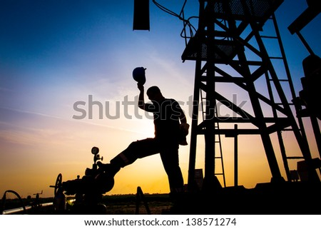 Oil worker silhouette - stock photo