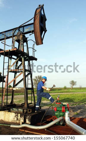 oil worker with hammer  - stock photo