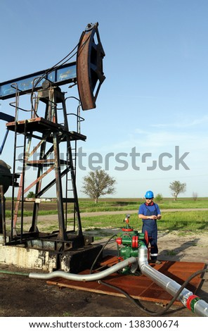 oil worker with tablet pc check pipeline - stock photo