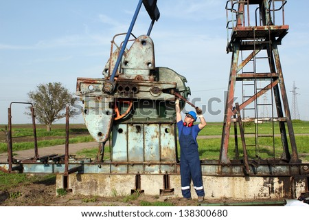 oil worker working on oilfield - stock photo