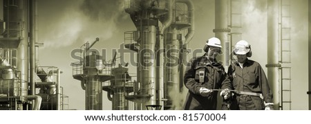 oil-workers, engineers, large oil and gas industry in background, smog and smoke, panoramic view. - stock photo