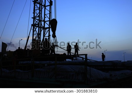 Oilfield derrick - stock photo