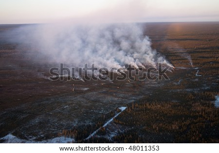 Oilsands development including slash and burn forest clearing in Northern Alberta - stock photo